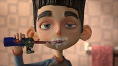 Norman brushes his teeth with his zombie toothbrush in ParaNorman