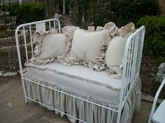 It's not only an antique baby bed turned love seat but it has the sweetest linens made from dropcloths.