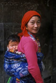 Staying close to baby. Wonderful baby wearing pictures from across the world and across the centuries.