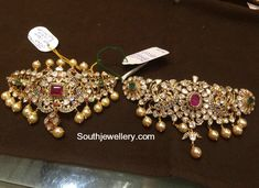 22 carat gold choker cum bajuband designs adorned with flat diamonds, rubies, emeralds and south sea pearls by Premraj Shantilal Jewellers. Indian Jewellery Design, Latest Jewellery, Indian Jewelry, Jewelry Design, Bridal Jewelry, Gold Jewelry, Choker Jewelry, Gold Necklaces, Diamond Jewellery