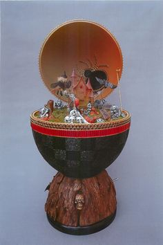 ...and mechanical... This Halloween egg was made by Harumi Baloy. According to the rules, there should be three different mechanical parts at work here... for example, a light, music box, automaton... that kind of thing. I don't know what this egg does, but it's made of a real egg.
