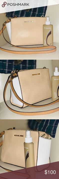 9658748b861a Micheal Kors small crossbody in good condition Cute purse also comes with  protection spray bought at