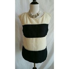 I just discovered this while shopping on Poshmark: Ann Taylor Size MP Blue Ivory Sleeveless Top. Check it out! Price: $18 Size: MP