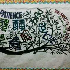 "High school bulletin board. ""Fruits of the Spirit"" traced on white bulletin board paper."