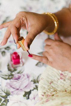 woman applying nail polish by Lia & Fahad | Stocksy United