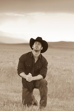 A man who kneels in prayer and where's a cowboy hat? I'm in <3