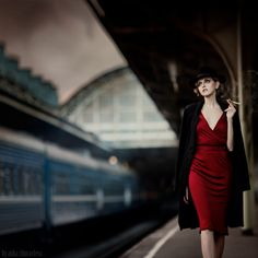 *** by Anka Zhuravleva on 500px  Woman in red dress at train station