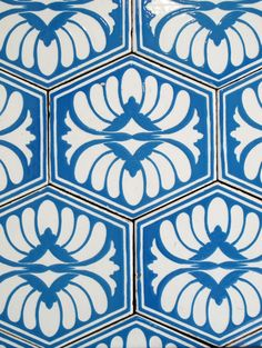 Blue tiles with flower detail.