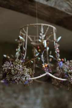 Woodland moss, twig and wild flower lampshade. Perfect rustic woodland wedding inspiration!