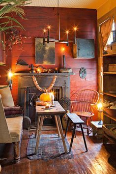 love the red wall and fire place
