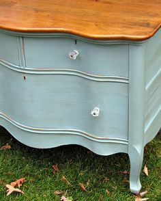 Annie Sloan Chalk Paint in a mix of Duck Egg Blue, Louis Blue and Provence.  Distressed the dresser and finished with the Soft Wax in Clear and Dark.