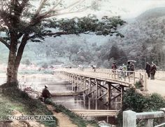 1880's. A man is fishing while women in kimono cross Togetsukyo (literally, bridge to the moon) in Kyoto's Arashiyama. The buddhist temple Horinji can be seen on the hillside at the far end of the bridge. The bridge received its poetic name after Emperor Kameyama (1249-1305) mentioned that the bridge appeared to stretch to the moon.