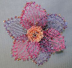 Free Knitting Pattern for Diamond Jubilee Wire Flower - This bead and wire knit flower design by Fiona Morris can be used as jewelry or decoration. Also comes with a pattern for wire and bead necklace and bracelet.