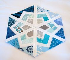 What a beautiful design! This pin leads to a blog with a link to the free paper pieced pattern by Shape Moth. The color combinations are endless with thousands of fabrics to choose from at the fabric Shack at http://www.fabricshack.com/cgi-bin/Store/store.cgi Repinned: 3x6bluehex via playcrafts