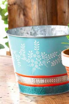 Break out the stencils for a custom, DIY garden planter you can create this summer!