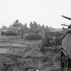 Sherman tanks, towed 6-pdr anti-tank guns and carriers of 8 Corps assembled for an attack, 24 September 1944.