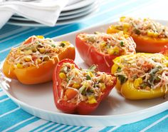 Confetti Stuffed Bell Peppers: Pairing fresh bell peppers with a frozen vegetable blend allows you to enjoy a bounty of nutrients while keeping the prep work manageable. #KidsCookMonday #MeatlessMonday