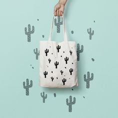 """Tote Bags Canvas Tote Bag Cactus  Canvas Tote by totebagdodobob  Totes are that universal product that everyone needs and uses. A book bag, a grocery bag, or just somewhere to throw in all of those little everyday items.  100% Bull Denim Woven Cotton construction Dimensions: 14 3/8"""" x 14"""" (36.5cm x 35.6cm) Dual handles Fabric weight 11.0 oz/yd² (373 g/m²) Superior screen printing results A cute, all-purpose natural cotton geometric tote bag."""