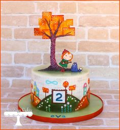Peg+ Cat themed cake for Eva's 2nd Birthday! This cake design is based on the PBS show; which is centered around math. I wrapped the cake with a graph paper edible image to create the background. All other decorations and characters are made from fondant and hand-painted
