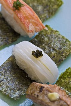 Nigiri sushi on nori strip (squid)