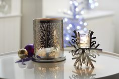 Enchanted Woodland Votive Hurricane and Silver Snow Votive Holder from PartyLite Get your PartyLite collection for free... ask me how at michellemybell4@hotmail.com  Independent PartyLite Consultant...