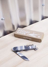 """Be prepared for anything with the Izola pocket knife. With a 2.25 inch blade and made from 100% stainless steel, it has four extremely useful tools - a corkscrew, large blade, bottle and can opener, and screwdriver. Don't be caught without one. Choose from the """"Do Something"""" or """"One for All"""" inscription."""