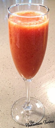 Sparkling Cranberry Mimosa | Only 100 Calories per Luscious Cocktail | For MORE EXERCISES & RECIPES please SIGN UP for our FREE NEWSLETTER www.NutritionTwins.com