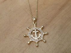 gold ships wheel necklace.