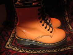 item was worn once for a wedding for a few hours. authentic doc martens made in england.orange patent leather. size 6UK US 8.Measure 24.0 cm toe to heel on inside.a few scuffs and large black spot on inner right boot. measures 11.0 inches toe to heel, 4.0 inches widest portion.from smoke pet free home. sorry all sales are final.no refunds returns or exchanges.email w/ questions.positive feedback only. if you have a issue w/ the item please contact me to resolve it. thanks again.