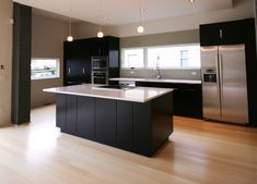 Luxurious Bamboo Floors in Kitchen for Finding More Relaxing Accent : Cool Black And White Nuance Combined With Bamboo Floors In Kitchen Applied For Modern Kitchen That Illuminated By Trio Pendant Lamps Above Kitchen Island