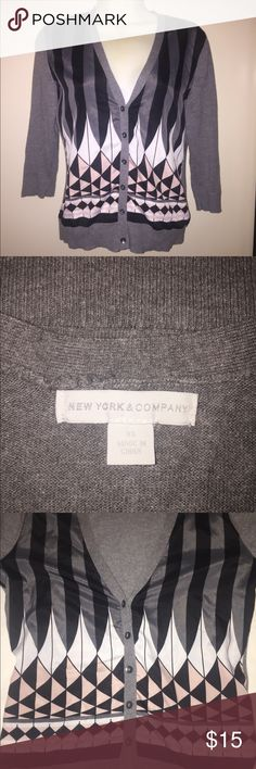 New York & Company size XS VERY CUTE cardigan Too cute of a print on his adorable 3/4 length sleeve cardigan by New York and company size XS pre worn good condition  53% cotton 50% rayon 7%nylon woven 100% polyester New York & Company Sweaters Cardigans