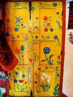 YELLOW DOOR LOVE THE PAINTINGS