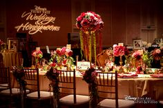 Gorgeous pink, red and gold reception decor at the 2015 Disney's Fairy Tale Weddings & Honeymoons Showcase