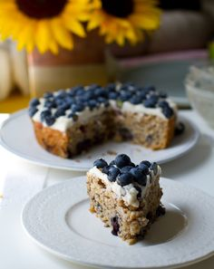 "Frosted Blueberry Cake...Blueberry muffin meets frosted cake meets hearty, grain-filled goodness. The frosting is a silky, fluffy ""buttercream"" type frosting. Use a GF flour blend."