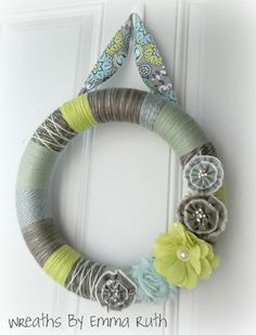 Funky Yarn Wreath! love the wreath and the color scheme for my living room!
