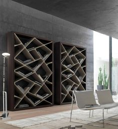 That a very unique bookcase. and dig the chairs too!