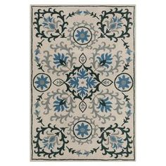 """Wool rug with a multicolor floral motif and cotton backing.   Product: RugConstruction Material: 100% WoolColor: Cream and blueFeatures:  Contemporary designCotton backing Dimensions: 5' x 7'6""""Note: Please be aware that actual colors may vary from those shown on your screen. Accent rugs may also not show the entire pattern that the corresponding area rugs have.Cleaning and Care: Professional cleaning recommended"""