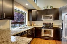 dark cabinets and granite counters, rehabbed house in Seattle