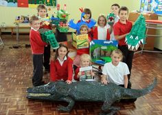 """These students from Brinsley Primary School are proudly displaying the projects they made based on """"The Enormous Crocodile"""" by Roald Dahl."""