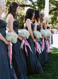 dark blue bridesmaid dresses with white baby's breath bouquets and long pink ribbon