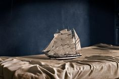 """Ara Solis"" (series of photos of model ships sailing across rumpled beds) by Luis González Palma"