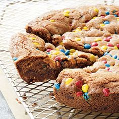"This recipe, a variation of one in her book Batter Up Kids Delicious Desserts cookbook, is from best-selling cookbook author and kids' cooking expert Barbara Beery, the founder of Batter Up Kids, Inc. ""Kids adore giant cookie 'cakes' for birthday and team sport parties,"" says Barbara. Baking it in a cast iron pan is an easy way to keep the cookie perfectly round."