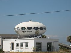 Spaceship House, Pensacola Beach  Finnish architect Matti Suuronen designed the Futuro house in 1968, initially for use as a ski-cabin or holiday home. He utilized the new plastic technology to create a light, easy to assemble and mobile home. The idea behind the design reflects the optimism of the sixties. The ideal was of a new era, a space age, where everybody would have more leisure time to spend on holidays away from home.