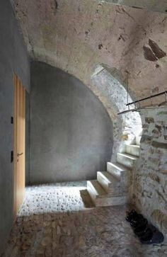 Wespi deMeuron, Romeo house renovation, Scaiano 2014.  Here stairs to puncture original wall, with new concrete, part of (apparently new) reinforcement of original structural arch at ground floor level.