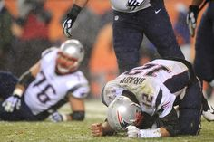 Quarterback Tom Brady #12 of the New England Patriots reacts to a play against the Denver Broncos in the fourth quarter at Sports Authority Field at Mile High on November 29, 2015 in Denver, Colorado.