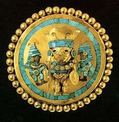 Earring of Lord of Sipán from ancient Peru, between 200 BD to 700 AD.  Gold, turquoise and wood