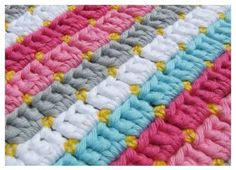 Not in English, but looks really simple, and there is a graph. Looks to be *single crochet, chain two, single crochet* then double crochet three into the chain two space on the next row.