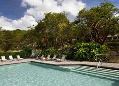 TravelPriceHunters - Caneel Bay Resort...  Offering well-appointed rooms with mini bars, the Caneel Bay Resort has its own beach. Just a short walk from the coast, this large resort is ideally located for those in search of a beach-side escape.   For fitn