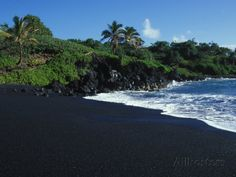 Olive-green sands of Papakolea Beach are located near the southern tip of Hawaii's Big Island.