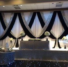 Beautiful white black and silver #weddingbackdrop and #tabledecor